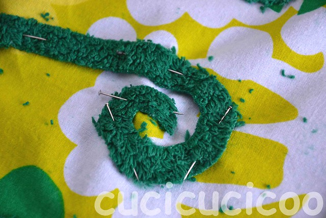 spiral appliqué pinned on to swimming pool locker room foot mats