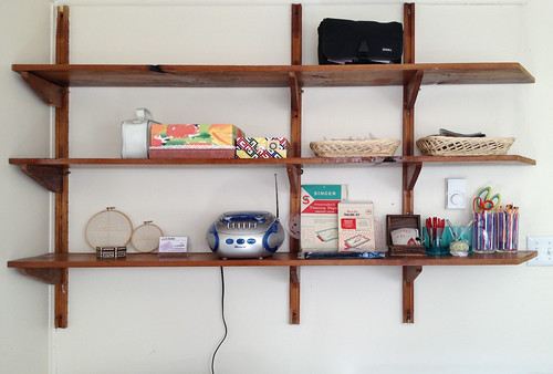 Wall shelf of random things (mouse-over notes)