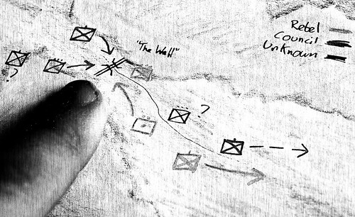 finger pointing at a The Last Council map with confusing military formations drawn on it