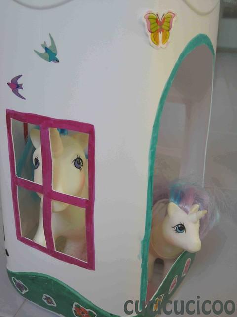 my little pony peeking out of plastic bottle house