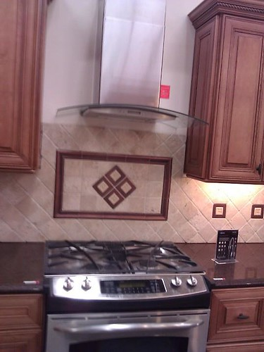 Travertine tile with copper insert accents