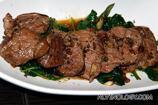 Sliced beef tenderloin Tagliata with rosemary and spinach