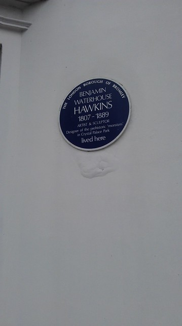 Benjamin Waterhouse Hawkins black plaque - Benjamin Waterhouse Hawkins 1807-1889 artist and solicitor, designer of the prehistoric 'monsters' in Crystal Palace Park lived here