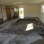 Concrete garage slab demolition and removal in progress.