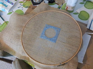 Using embroidery hoop to pull hessian taut before gluing