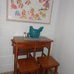 Tue, 04/02/2013 - 09:37 - Eat in kitchen has compact table and stools.