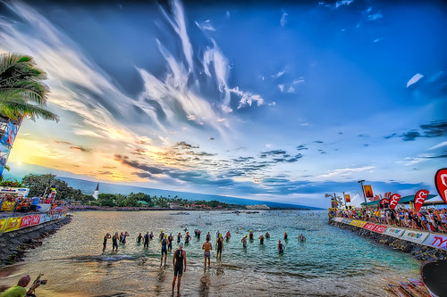 ocean morning sunrise hawaii colorful warm day cloudy ironman swimmers spectators kailuakona competitors