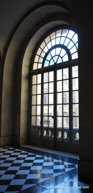 Marble Checkerboard Floor and Arched Window at the Louvre Museum in Paris