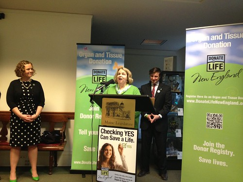 Organ recipient Emily Sherwood shares her story as Rep Megan Rochelo and Matt Boger of New England Organ Donor Bank look on.