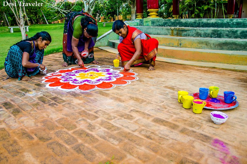 making rangoli design with colors