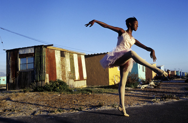 Ballet dancer strikes a pose outside her home in Khayelitsha, So