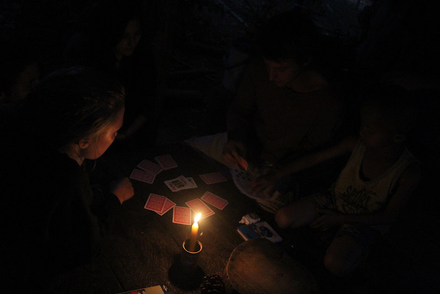 Playing cards by candlelight on a farm in Thailand