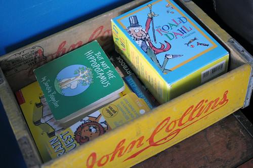 books in soda crate