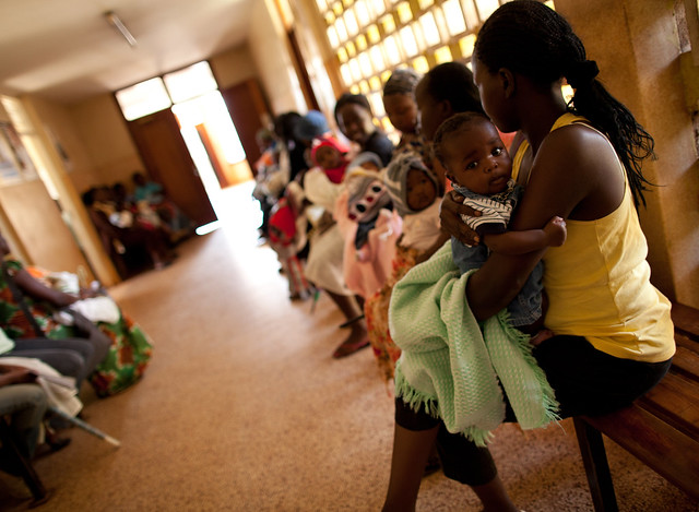 Mothers wait in line to receive vaccines for their children