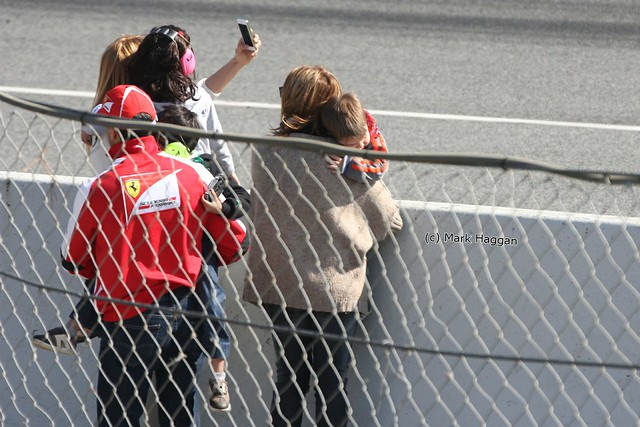 Ferrari driver Marc Gene with his children at Formula One Winter Testing 2013