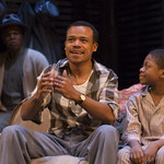 Corey Allen, LeRoy McClain ('Walter Lee Younger'), and Corey Janvier ('Travis Younger'), in the Huntington Theatre Company's production of Lorraine Hansberry's A RAISIN IN THE SUN. Mar. 8 - Apr. 7, 2013 at Avenue of the Arts / BU Theatre. huntingtontheatre.org. photo: T. Charles Erickson