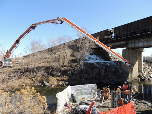 Photo of concrete pour for support pier on Gold Line commuter rail bridge over Clear Creek