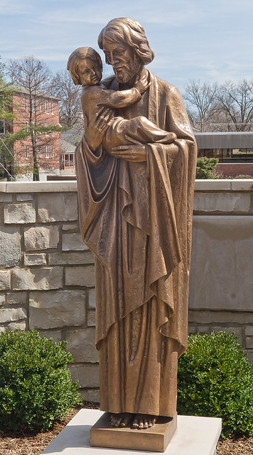 Saint Joseph Roman Catholic Church, in Clayton, Missouri, USA - bronze sculpture of Saint Joseph and the Christ Child - in garden