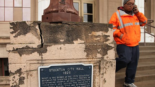 Stockton, California city employee leaves a damaged City Hall amid a battle over whether the municipality can file bankruptcy and shed some debt owed to its creditors. The situation in Stockton represents a test case for the future of the debt crisis. by Pan-African News Wire File Photos