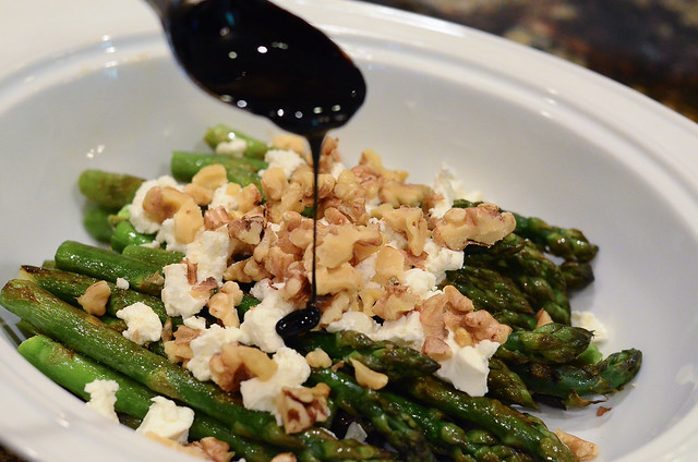 Balsamic reduction is drizzled on top of the asparagus.