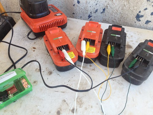 Charging Up the Weed Wacker Batteries by mikey and wendy