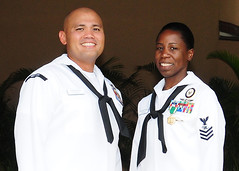 Hospital Corpsman 1st Class (FMF) Joseph Santos, left, and Mass Communication Specialist 1st Class (AW/EXW/IDW) Cassandra Thompson, pose for a photo after the announcement of the 2012 Pacific Fleet Sailors of the Year, April 12. (U.S. Navy photo by Chief Mass Communication Specialist Paula Ludwick)
