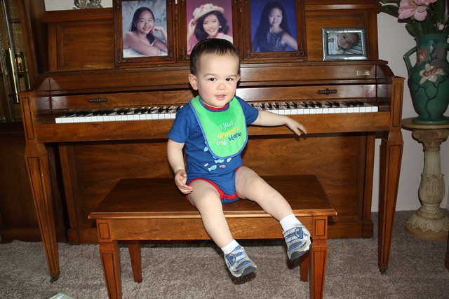 Sitting on the piano bench