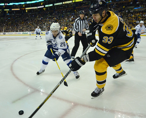 Boston Bruins defenseman Zdeno Chara (33) and Tampa Bay Lightning right wing Martin St. Louis (26) during the third period of a NHL game in Boston on April 25th, 2013.  The Bruins beat the Lightning 2-0.(Photo: Brian Fluharty)