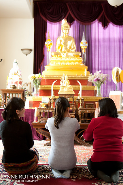 Praying and kneeling before buddha