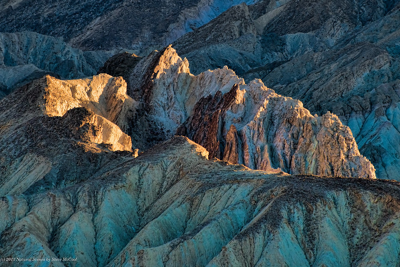 Sun-touching-rocks-at-Zabriskie-Point