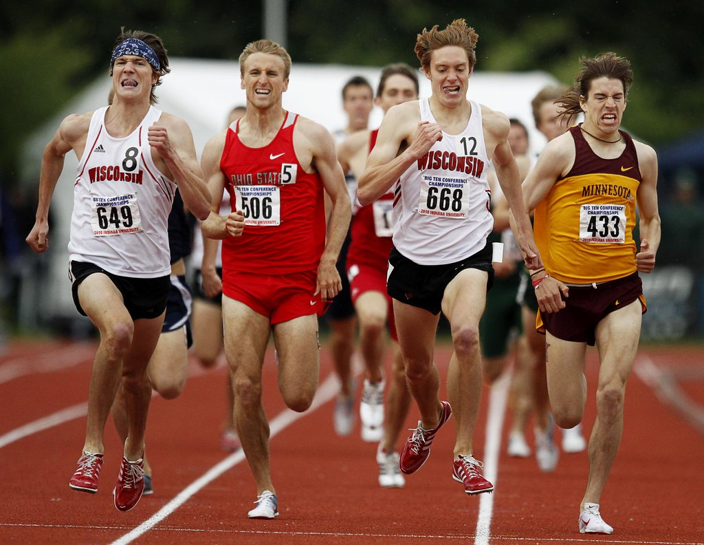 Jack Bolas, Jeff See, Craig Miller, and Ben Blankenship sprint down the home stretch of the 1500M finals at the Big 10 Track and Field Championships in Bloomington, In. on May 16, 2010.  All four would finish within a second of each other, with Jack Bolas edging out teammate Craig Miller for the gold with a time of 3:43.79.
