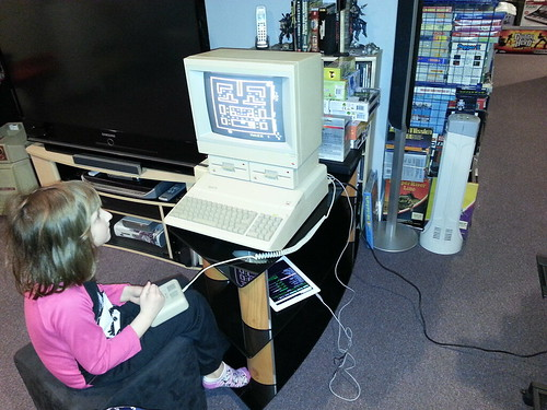 Olivia playing Snack Attack on the Apple II.