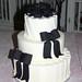 black bows: white pinstripes wedding cake