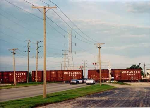 Former Milwaukee Road box cars crossing West 71st Street.  Bridgeview Illinois.  Early September 1989. by Eddie from Chicago