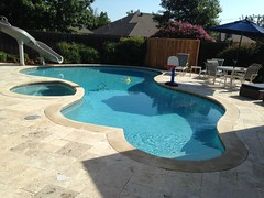After Travertine Pavers on Deck Leuders Coping Sunstone Plaster and New Slide