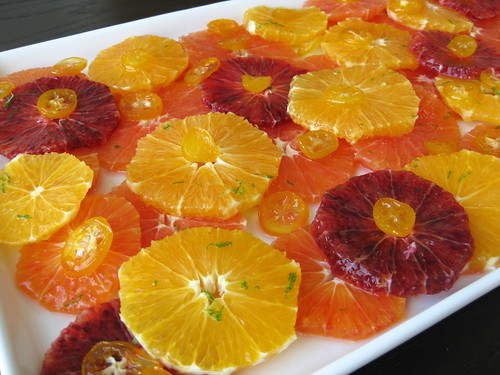 orange salad with candied kumquats and citrus syrup