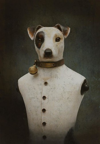paper mache dog dressed in clothing