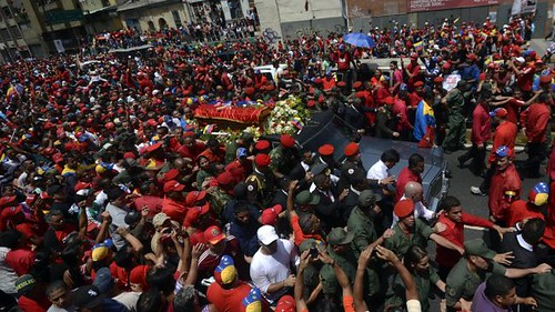 Hundreds of thousands of Venezuelans walk behind the body of President Hugo Chavez on March 6, 2013. The whole of Latin America have paid tribute to the revolutionary leader. by Pan-African News Wire File Photos