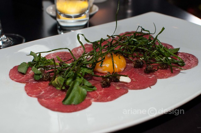 Spring Creek beef carpaccio, fried capers and watercress, 68 degree egg yolk, smoked olive oil