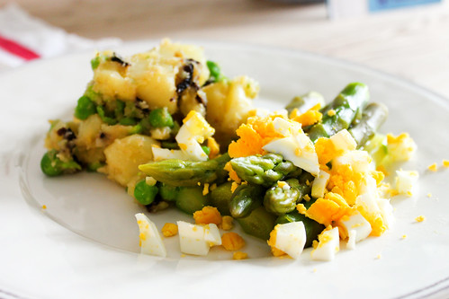 stomping potatos with peas and olives. green asparagus with chopped egg