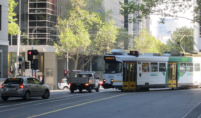 The car backs into the correct lane, and the tram continues on