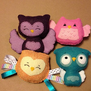 #felt #plush #owl baby toys hand stitched by One Sweet Stitch with pattern by #Noialand. Purple crinkle owl, pink crinkle rattle, orange taggie, and teal crinkle squeaky toy.