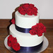 Navy ribbon and red roses wedding cake
