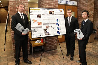 Rail Car Coupler Team with poster and holding project
