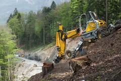 logging(0.0), track(0.0), bulldozer(0.0), soil(1.0), vehicle(1.0), forest(1.0), construction equipment(1.0),