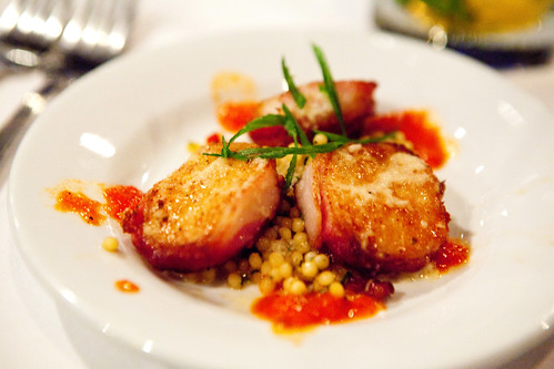 Bacon wrapped scallops with couscous, bell pepper sauce