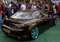 race track(0.0), automobile(1.0), wheel(1.0), vehicle(1.0), performance car(1.0), automotive design(1.0), auto show(1.0), land vehicle(1.0), luxury vehicle(1.0), mazda rx-8(1.0), supercar(1.0), sports car(1.0),