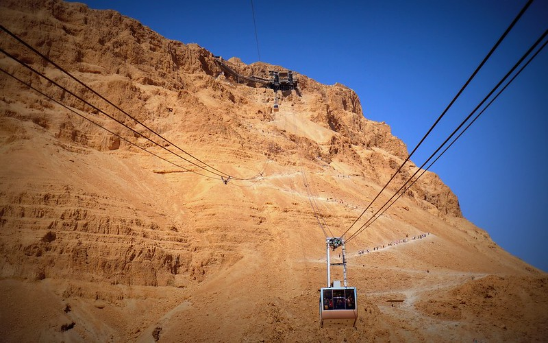 The cable car up to Masada and the Snake Path below.