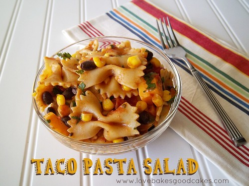Taco Pasta Salad in a clear bowl with a fork.