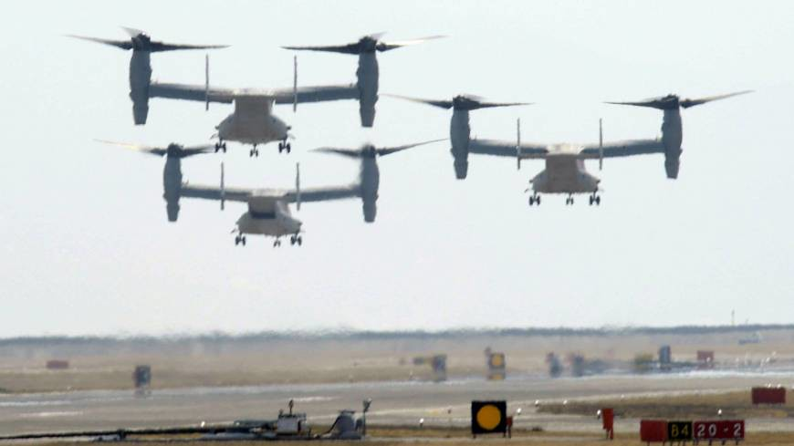 Hybrid transport: Three Osprey MV-22 transport aircraft depart U.S. Marine Corps Air Station Iwakuni in Yamaguchi Prefecture on March 8. | KYODO